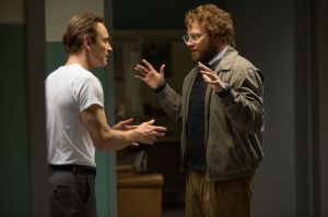 """In this image released by Universal Pictures, Michael Fassbender, left, as Steve Jobs, and Seth Rogen as Steve Wozniak, appear in a scene from the film, """"Steve Jobs."""" The movie releases in U.S. theaters on Friday, Oct. 9, 2015. (Francois Duhamel/Universal Pictures via AP)"""